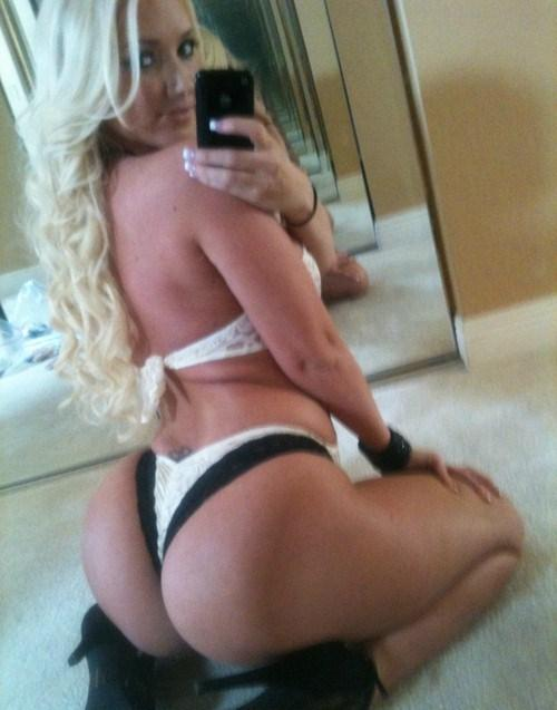 Anonymous in lingerie taking a selfie