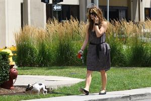 Ashley Greene walking her dog around her hotel in Detroit on July 17, 2010