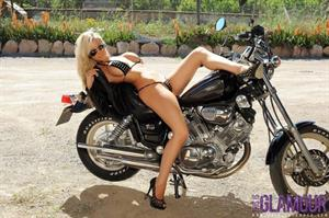 Cara Brett on a motorcycle