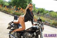 Cara Brett on a motorcycle
