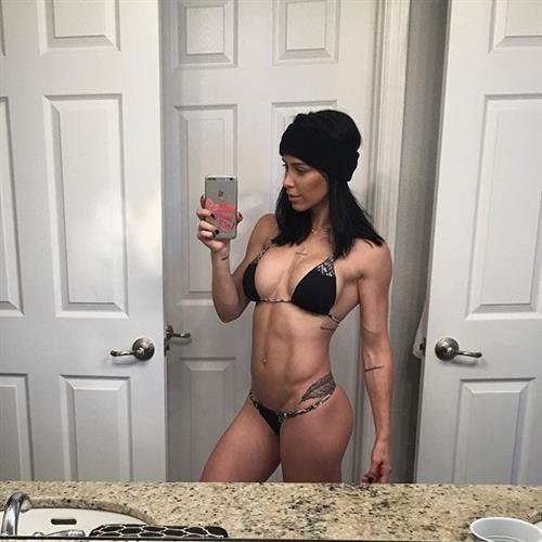 Bella Falconi in a bikini taking a selfie