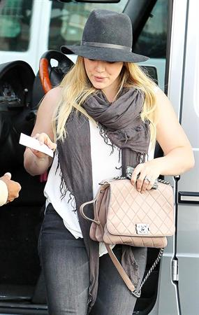 Hilary Duff Out in Los Angeles, August 30, 2012.  She's wearing jeans and a hat