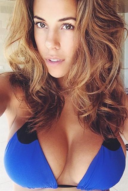 Devin Brugman in a bikini taking a selfie