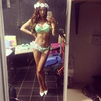 Laura Carter in a bikini taking a selfie