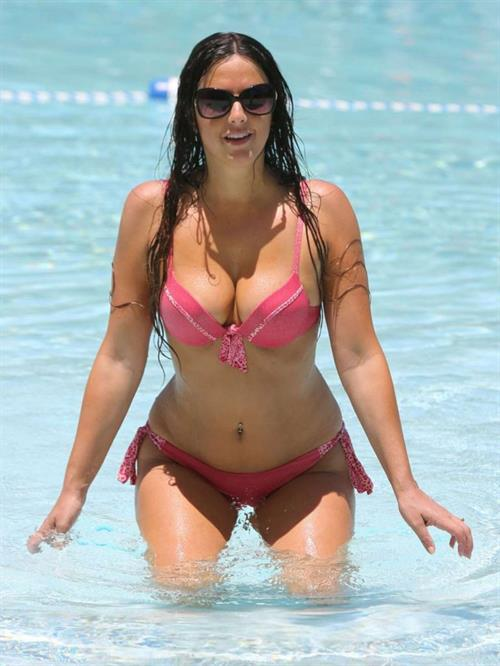 Claudia Romani takes a dip in a pool