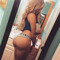 Courtney Tailor taking a selfie and - ass