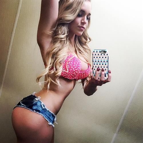 Courtney Tailor in a bikini taking a selfie