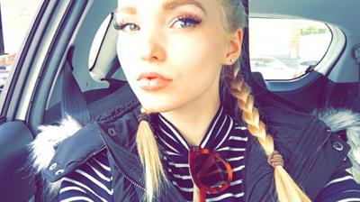 Dove Cameron taking a selfie