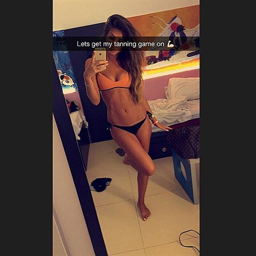 Megan McKenna in a bikini taking a selfie