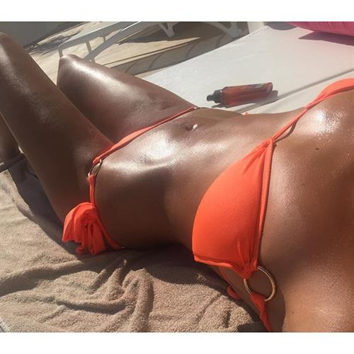 Megan McKenna in a bikini taking a selfie