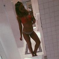 Natalie Alyn Lind in a bikini taking a selfie