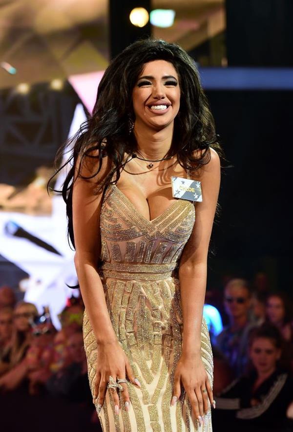 Chloe Khan in boob flashing dress