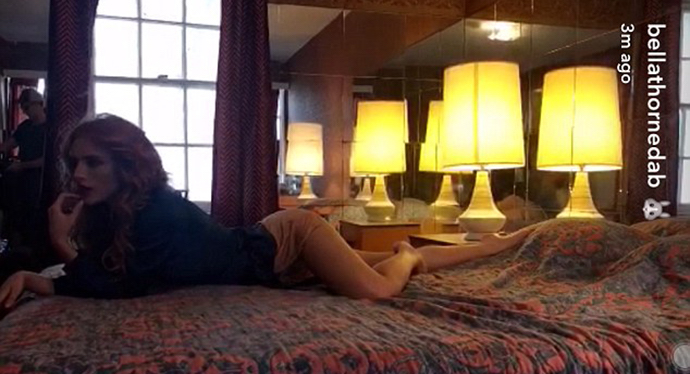 Bella Thorne posing in bed