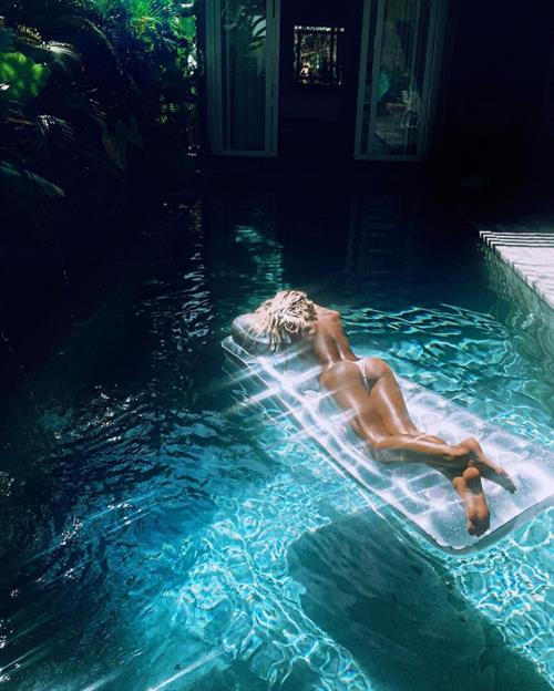 Angelina Jolie in a bikini - ass