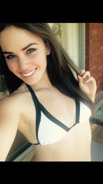 Alexis Young in a bikini taking a selfie