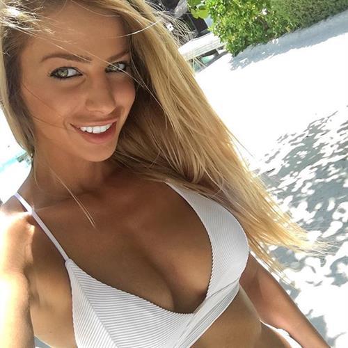 Yanita Yancheva in a bikini taking a selfie