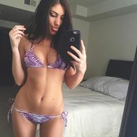 Christy May in a bikini taking a selfie