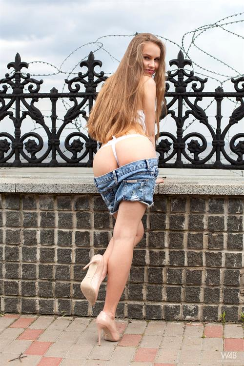 Lucretia K on a fence for Watch4Beauty