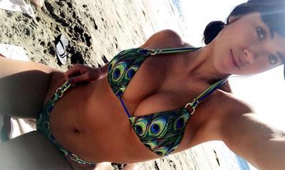 Arianny Celeste in a bikini taking a selfie