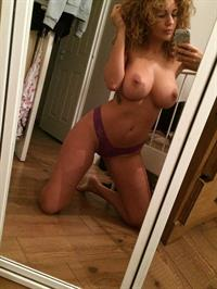 Holly Peers taking a selfie and - breasts