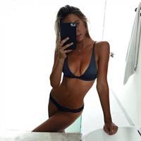Alexis Ren in a bikini taking a selfie