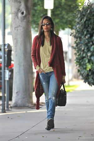 Zoe Saldana out and about in West Hollywood wearing a long red sweater coat January 19-2012
