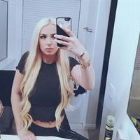 Tana Mongeau taking a selfie