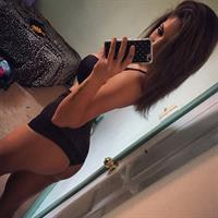 Libby Powell in a bikini taking a selfie and - ass