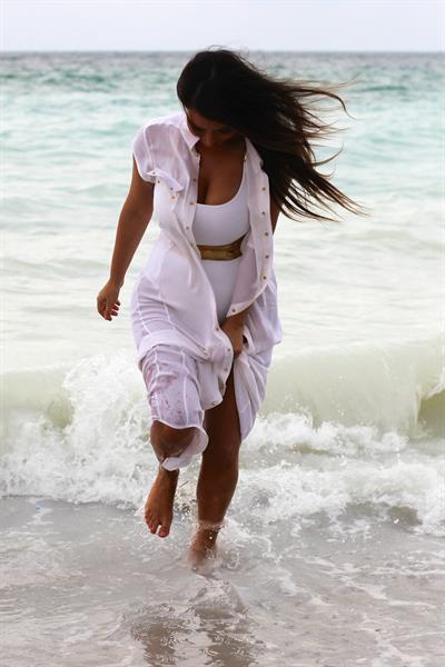 Kim Kardashian in a swimsuit at Miami beach 9/24/12