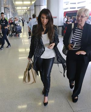 Kim Kardashian catches a flight out of Miami October 4, 2012