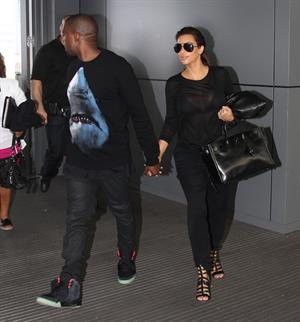 Kim Kardashian - JFK airport in New York on August 9, 2012