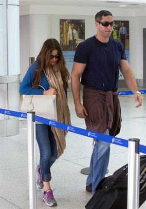 Sofia Vergara prepare to depart LAX, August 25, 2012