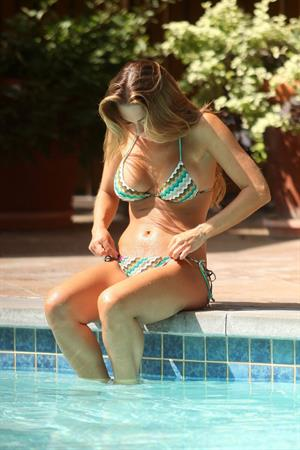 Adele Silva poolside in a bikini in Dubai on February 21, 2012