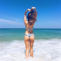 Ingrid Schneider in a bikini - ass