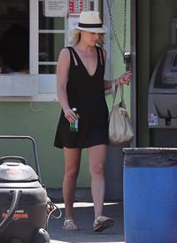 Ali Larter - Leggy in Black Dress at a Car Wash in Hollywood - August 9, 2012