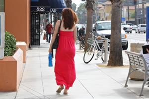 Alyson Hannigan in a red dress in Santa Monica on August 20, 2012
