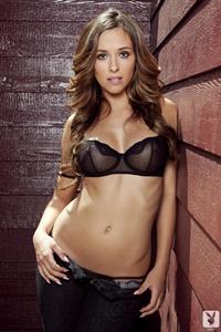 Beautiful adult model Jessika Alaura in tight jeans.