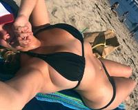 Hunter McGrady in a bikini taking a selfie