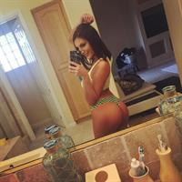 August Ames in a bikini taking a selfie and - ass