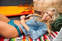 Playboy Cybergirl Kayla Rae Reid goes surfing nude