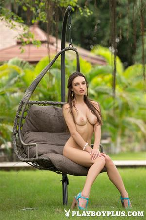 Playboy Cybergirl Gloria Sol Nude on an outdoor swing
