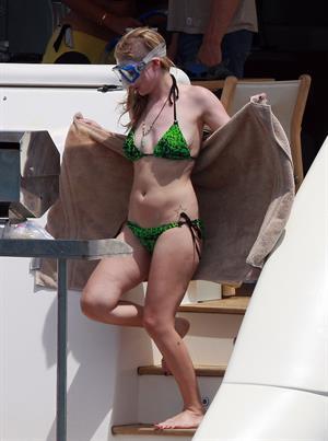 Avril Lavigne in a green bikini in Cabo, Mexico on July 27, 2012