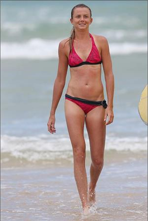 Daniela Hantuchova bikini beach surfing candids in Brisbane, Australia, December 26, 2012