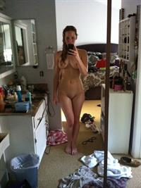 Jennifer Lawrence taking a selfie and - breasts