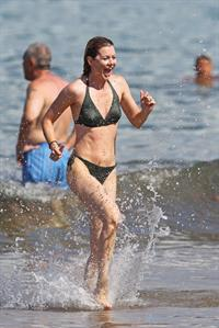 Ellen Pompeo - Wearing a sexy wet bikini on a beach in Maui (June 6, 2012)