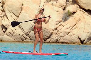 Victoria Silvstedt wearing a bikini on a board in Sardinia on August 8, 2012