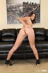 Amber Rayne nude on a leather couch for Cherry Pimps
