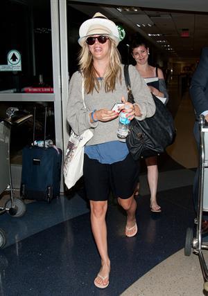 Kaley Cuoco at LAX on April 26, 2012