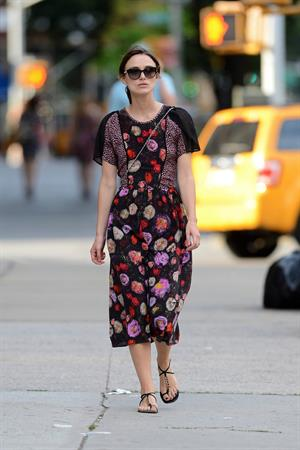Keira Knightley wears a dark floral dress while strolling in New York City on August 7, 2012