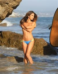 Leilani Dowding on the set of a sexy topless photoshoot for Moday Swimwear on the beach in Malibu on August 22, 2013